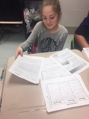 A student organizes her ideas before writing.