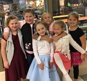 Dressed in 50's style, students celebrate 50 schools days completed.