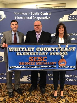 WCEE Principal Mike Partin (center) receives accepts award for WCEE student KPREP performance.