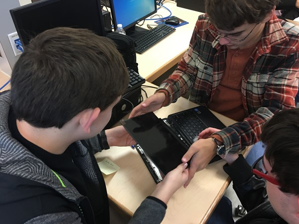 Students in Mr. Brian Logan's class repairing chromebooks at WCHS.