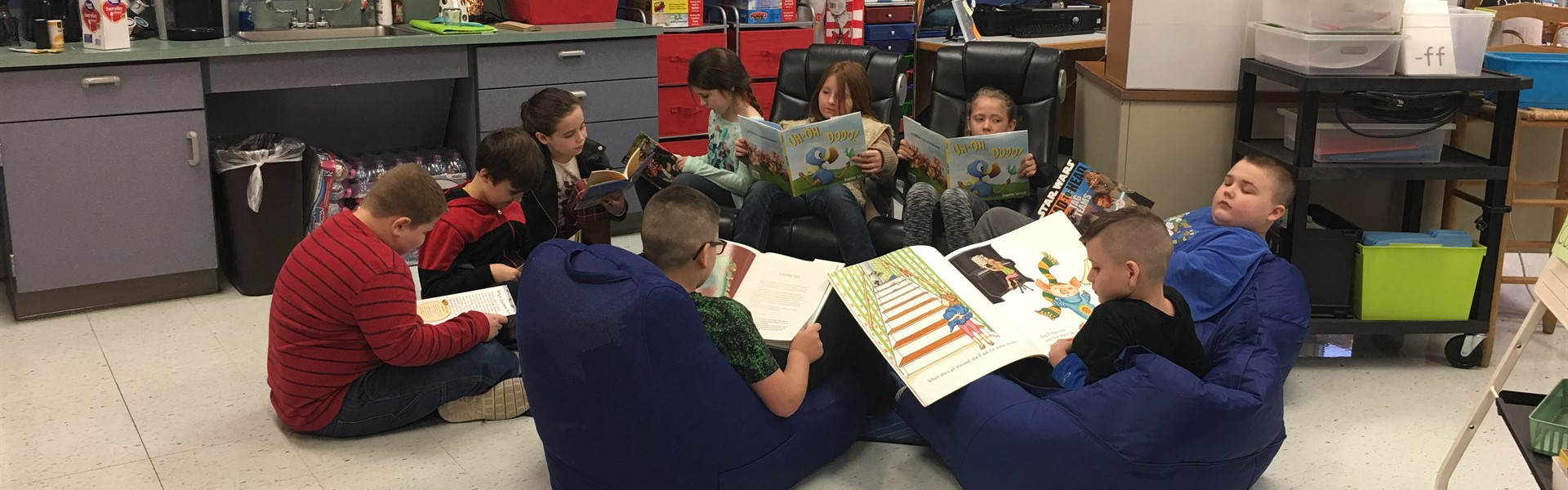 Students enjoy books donated by the Save the Children Program.