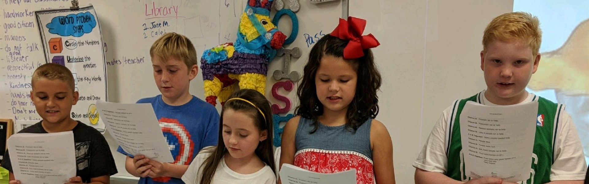 Fourth grade students honor heroes during a reader's theater activity  on Patriot's Day.